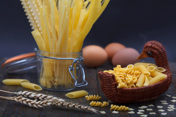 Different kinds of tagliatelle, spaghetti and other pasta with eggs. italian foods concept.