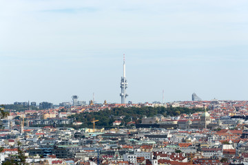 Prague panorama with colorful rooftops, with Zizkov television tower in the distance