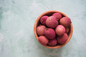 Delicious lychees in a bowl. Top view.
