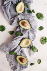 High angle view of avocados with basils and fabric on table