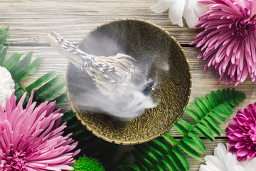 Burning Sage Smudge with Spring Flowers