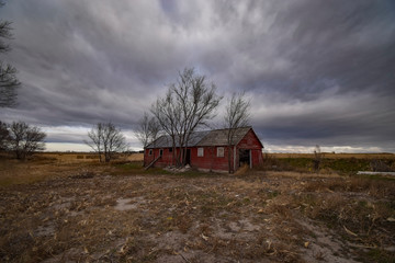 View of barn against stormy clouds