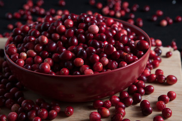Close-up of fresh cranberries in bowl on table