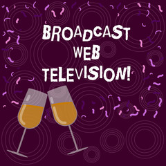 Writing note showing Broadcast Web Television. Business photo showcasing media presentation dispersed over the Internet Filled Wine Glass for Celebration with Scattered Confetti photo