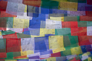 High angle view of colorful prayer flags hanging outdoors