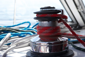 Close-up of rope rolled to winch on boat