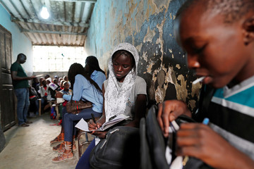 Children do their homework in Medina neighbourhood, Dakar