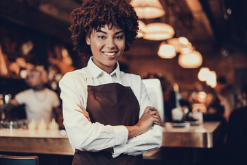 Young employee lady looking at camera and smiling