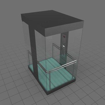 Glass elevator with door closed