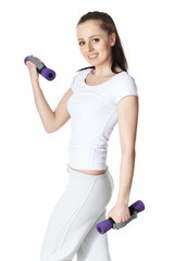 Young sports woman with dumbbells.