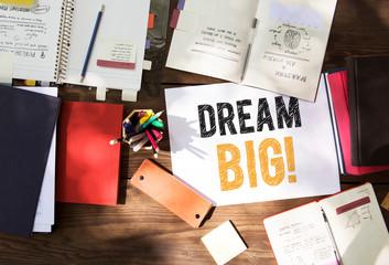 Phrase Dream big in a workspace