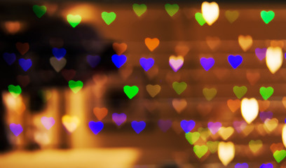 Defocus bokeh garland heart in shop window showcase glare background texture