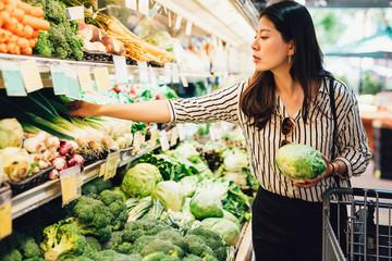 elegant female grocery shopping