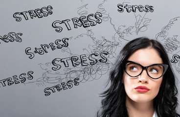 Stress theme with young businesswoman in a thoughtful face