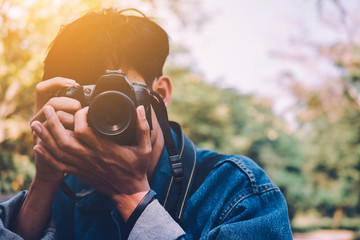 Man holding camera take photo