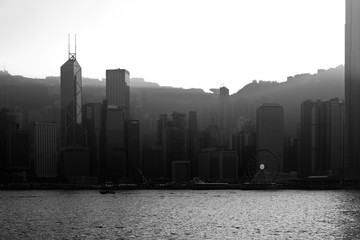 Tuinposter Dubai Silhouette of Hong Kong Victoria Harbour. During sunset; Black & White Color