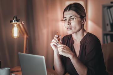 Musing female freelancer editing article