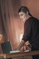 Pleasant female freelancer working at night