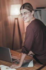 Joyful female freelancer studying markets