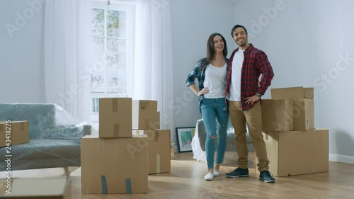 Hy Young Moving Into New Apartment Carrying Cardboard Boxes With Stuff Having Fun Give High Five Boyfriend And Friend Start Living
