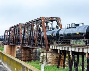 railroad trestle with train cars near amistad recreational area.