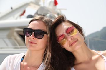 Two beautiful girls near the sea