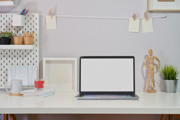 Minimalist stylish workspace isolated screen laptop and copy space