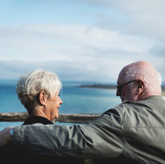 Senior couple enjoying the view of the ocean