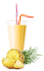 A glass of pineapple smoothie or yogurt with sliced pineapple