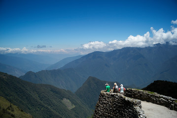 hikers take in a view of mountains