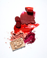 Creative beauty fashion concept photo of cosmetic swatches on white background.