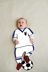 Baby dressed up as football player