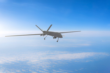 Unmanned military drone on patrol air at high altitude. Wall mural