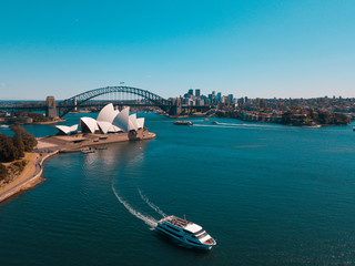 Deurstickers Sydney January 10, 2019. Sydney, Australia. Landscape aerial view of Sydney Opera house near Sydney business center around the harbour.