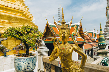 The beauty of the Emerald Buddha Temple . And while the gold of the temple catching the light. This is an important buddhist temple of thailand and a famous tourist destination.