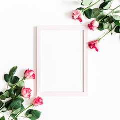Flowers composition. Pink rose flowers, photo frame on white background. Flat lay, top view, copy space, square
