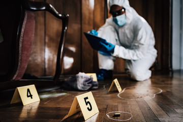 Crime Scene Detective Examining Evidence Wall mural
