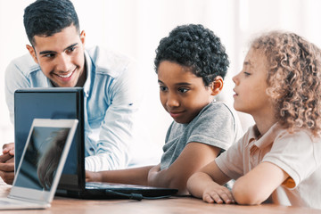 Smart boys and teacher during computer programing class for kids