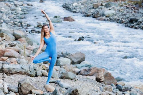 Seductive elegant female blonde yoga lover doing
