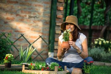 woman holding seedlings in her garden