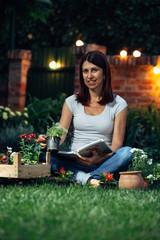 woman planting flowers in her garden