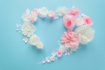 white and pink paper flowers on the pink background