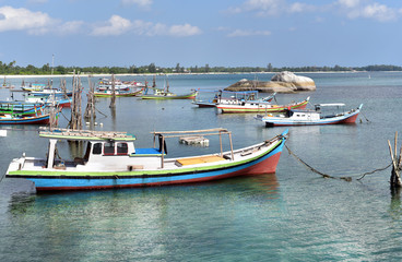 Traditional fishing boats in Pantai Batu Banyak Beach, Belitung Island, Indonesia