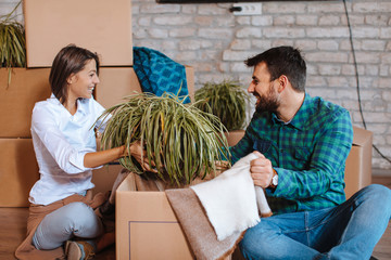 Young happy couple move to a new home