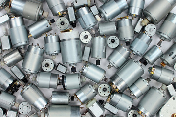Pile of old electrical dc motors