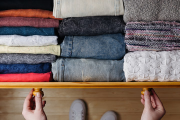 Neatly ordered clothes in drawer Wall mural