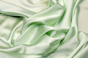 Satin silk fabric in light green color