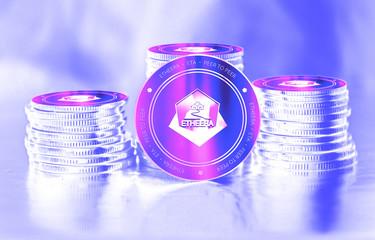 Etheera (ETA) digital crypto currency. Stack of coins. Cyber money.