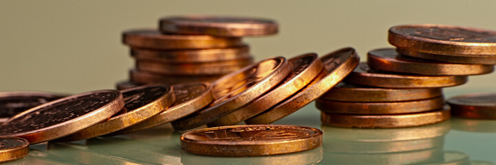 Stacks of euro and euro cent coins.  Web banner.