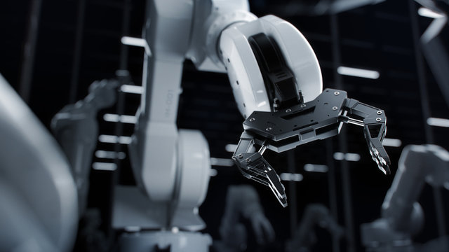 Industrial Concept: Close-up of New Generation AI  Robotic Arm Ready for Work on a Production Line. Computer Manufacturing. Dark Black Colors.